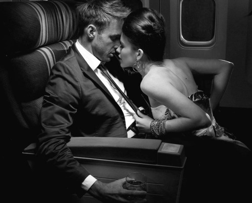 man-in-a-suit-on-a-plane-with-a-girl