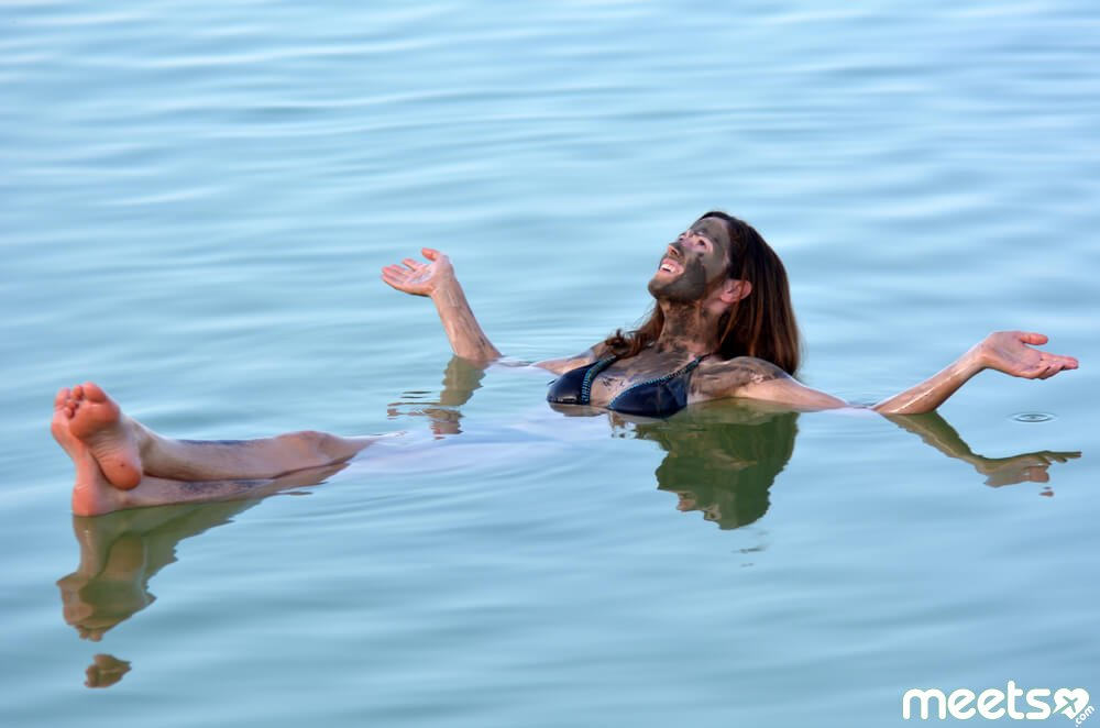 girl is bathing in the Dead Sea
