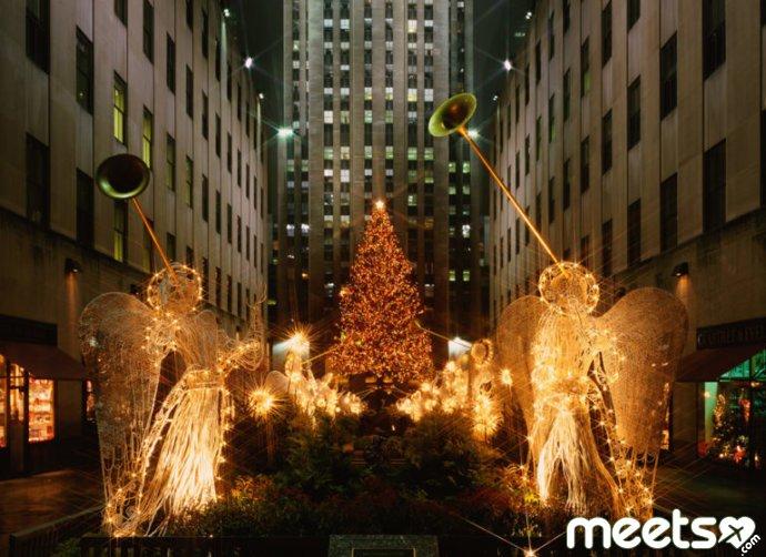 angels near new year tree